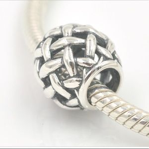 Authentic openwork basket knot charm